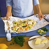 Preparing halibut fillets with vegetables