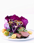 Sweet & sour red cabbage salad with kumquats & warm roast beef