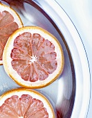 Slices of citrus fruit in syrup (for candying)