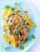 Marinated salmon cutlet on millet with oranges