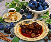 Plum compote, fresh plums and a cup of coffee