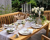Table with white decorations and goose eggs in open air