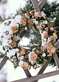 Dry wreath with roses and silver baubles
