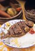 Crispy fried sea bream with sauce firire (Senegal)