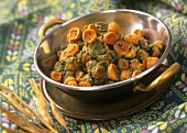 Dhania mangodi (Lentil dumplings with coriander sauce, India)