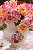 Arrangement of roses in nostalgic milk jug