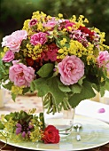 Summer arrangement of roses, lady's mantle & dianthus