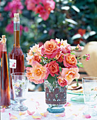 Vase of roses on a garden table