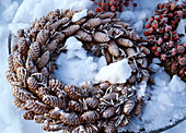 Wreath of fir cones in snow