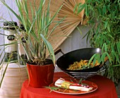 Still life with lemon grass and food in wok