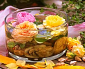 Perfumed roses in a bowl of water