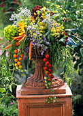 Colourful arrangement of vegetables in terracotta vase
