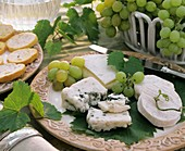 Mixed cheese board with grapes