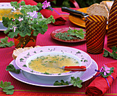 Chicken soup with noodles and scented geraniums