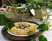 Farfalle with salmon cream sauce and scented geraniums