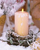 Candle with wreath of larch twigs