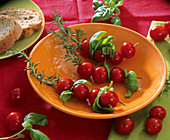 Spiedini aromatici (tomatoes skewered on rosemary with basil)