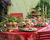 Laid table with vegetable decorations in open air