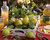 Pears on white wooden tray, pear juice and -compote