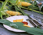 Place setting: maize leaf as place-card, taco chips & chili dip
