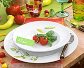 Tomato and basil on plate with place-card