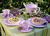 Grape tarts on table laid for coffee