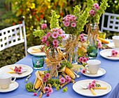 Summer table decoration with flowers