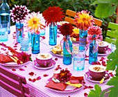 Dahlias in blue bottles and on napkins