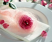Napkin decoration with rose and white angel's hair