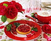 Redcurrant tarts, cappuccino and 'Flammentanz' roses