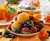 Plate of fruit with nasturtiums