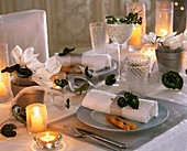 Table laid in silver and white with Cyclamen and herb dip