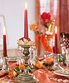 Candlestick with crystal hangings, rose petals & candle