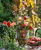 Glass with Perilepta branches, apples & leaves on sticks, rose