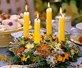 Table wreath with autumn flowers and candles
