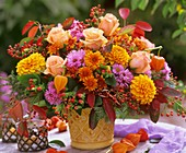 Autumn arrangement of roses, asters, dahlias, Chinese lanterns