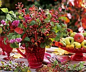 Arrangement of rose hips, raspberries and spindle berries