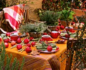 Table decoration with herbs and apples