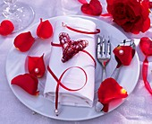 Napkin decoration with heart and rose petals