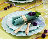 Place setting decorated with primulas and parsley