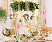 Easter table decoration with hanging wreath