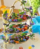 Tiered silver stand with coloured sugar eggs & forget-me-nots