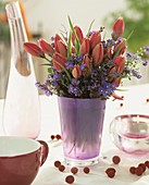 Arrangement of tulips and horned violets