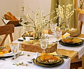 Table decoration of flowering sloe branches and bricks