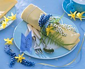 Place-setting with spring flowers and place-card