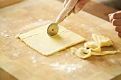 Cutting yeast dough with a pastry wheel