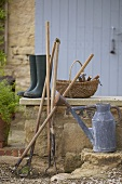 Various garden tools, watering can and rubber boots