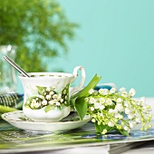Cup and saucer with lilies of the valley