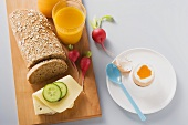 Boiled egg, cheese and cucumber on wholemeal bread