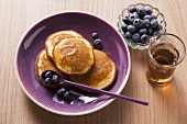 Buckwheat pancakes with blueberries and maple syrup